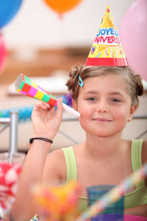 portrait of a little girl at birthday party photo