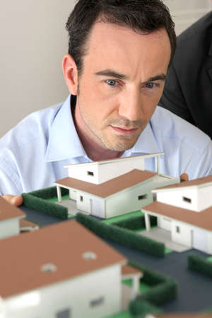 scale model: Architect staring at a model