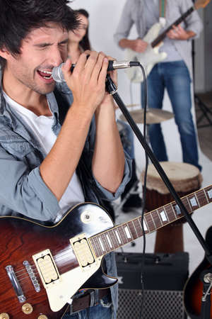 hair band: Man singing in a band Stock Photo
