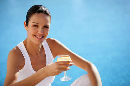 40 year old woman: Woman drinking glass of orange juice Stock Photo