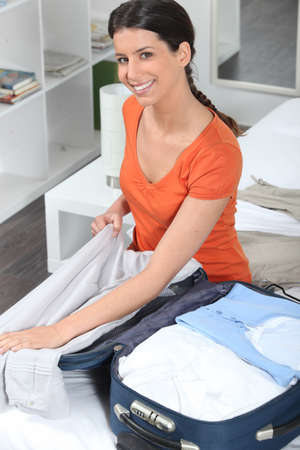 Cheerful woman packing Stock Photo