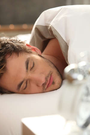 Man asleep in bed Stock Photo - 12132876
