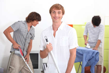 Young men cleaning Stock Photo - 12132507
