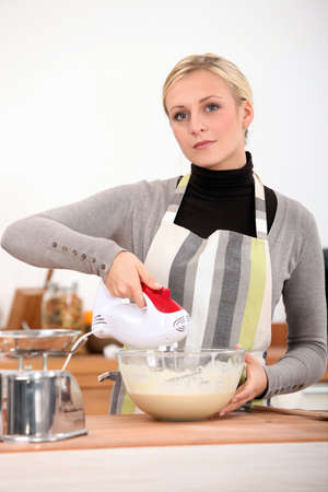 Woman mixing batter photo
