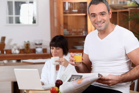 Couple enjoying breakfast together before work photo