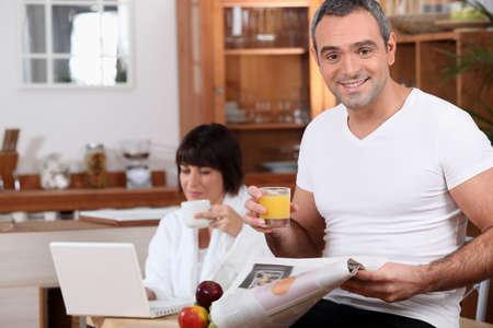 Couple enjoying breakfast together before work photo