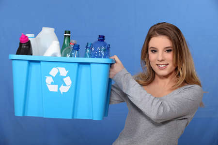 Girl recycling plastic bottles photo