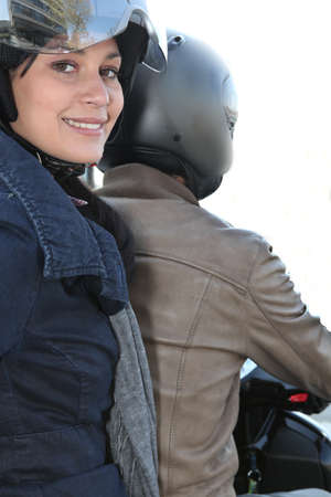 Young woman on the back of a scooter photo