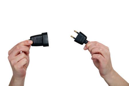 riek: handen die twee pin stekker Stockfoto