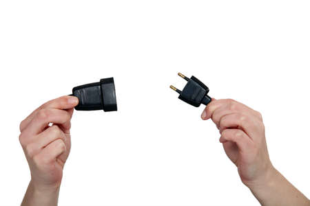 prong: hands holding two prong plug Stock Photo