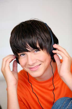 adolescents: Teenage boy listening to music