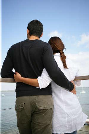Couple stood on pier photo