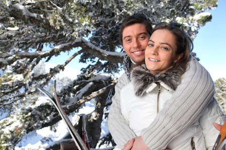 winter couple: Portrait of young couple in the mountain Stock Photo