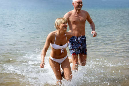 Cheerful couple bathing in the sea photo
