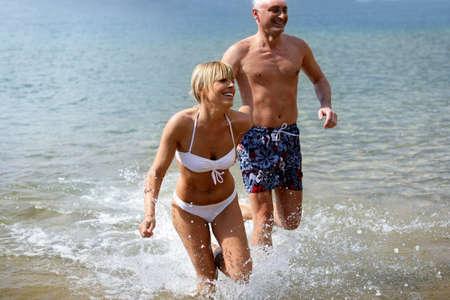 Cheerful couple bathing in the sea photo