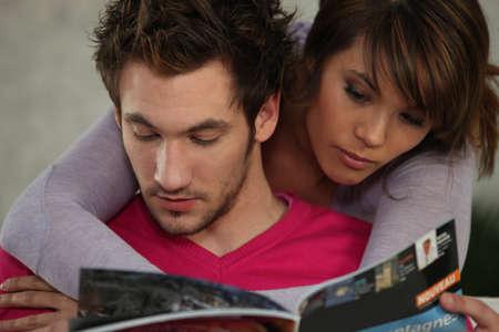 adult magazines: Couple reading magazine