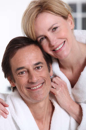 toweling: Portrait of loving couple in bathrobes