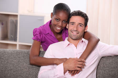 Couple together in their living room photo