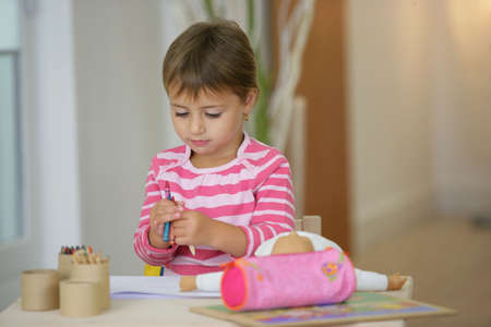 Girl with crayons photo