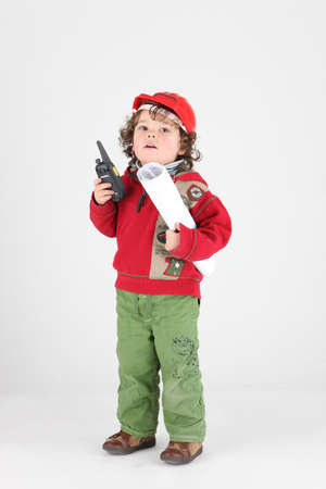 make belief: Young child dressed up as a tradesperson