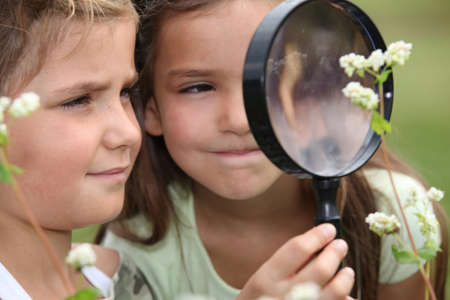 camping: Children with a magnifying glass Stock Photo
