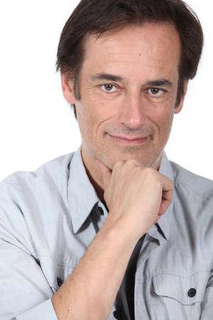 45 55 years: Man thinking holding chin.