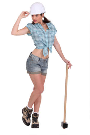 sledge hammer: A sexy female construction worker.