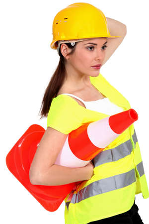 safety hat: A traffic controller carrying a pylon