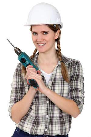 electric drill: Tradeswoman holding a power tool Stock Photo
