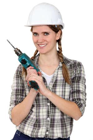 workwoman: Tradeswoman holding a power tool Stock Photo