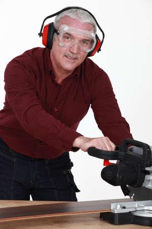 Man with a circular saw photo