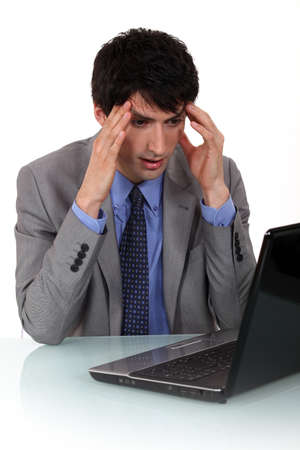 A businessman having a headache. photo