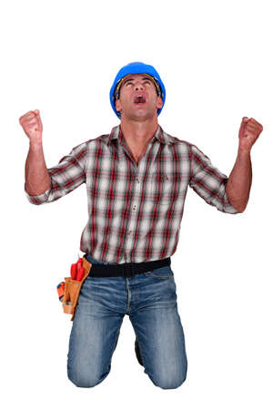 A male construction worker shouting. photo