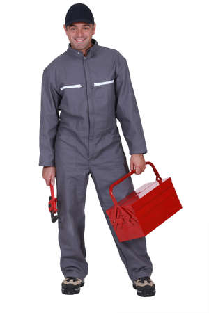 Plumber with wrench and tool box Stock Photo - 12132313