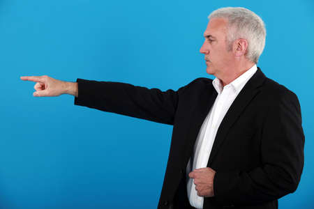 60 65 years: Businessman pointing his finger