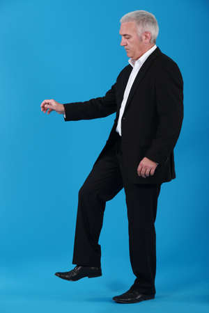 trample: Businessman stepping on an insect