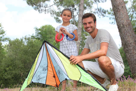 adroitness: a father and his daughter with a kite Stock Photo
