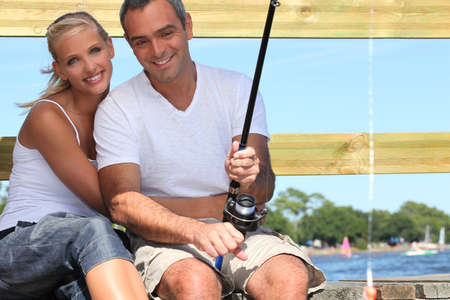 settle back: Couple fishing in the sun Stock Photo