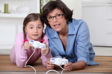 Mother and daughter playing video games photo