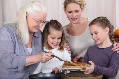 three generations: Three generations enjoying crepes Stock Photo