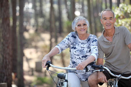 A mature couple on a bike ride. photo