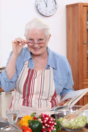 grannies: grandmother cooking in the kitchen Stock Photo