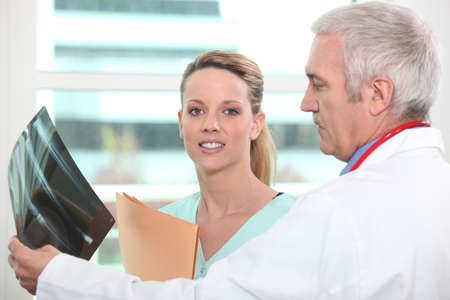 oncologist: Doctor and colleague examining x-ray