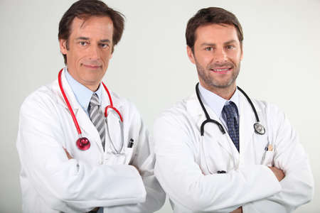 doctors smiling: portrait of 2 doctors Stock Photo