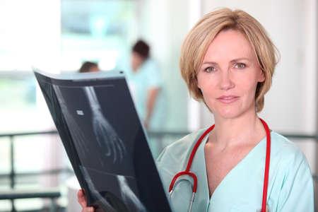 black nurse: Doctor examining an xray