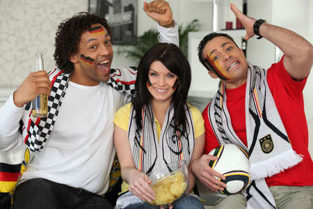 world sport event: Football fans cheering on the German team Editorial