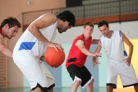 Basketball player dribbling photo