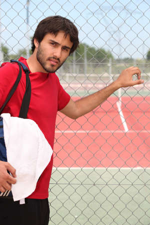 municipal court: Young man outside a tennis court Stock Photo