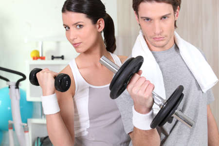 Couple using hand weights photo