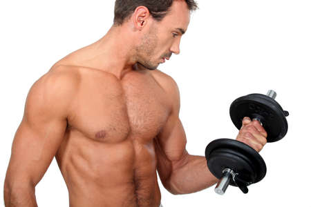 dark haired: portrait of a man with dumbbell
